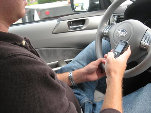 Driver texting while driving.