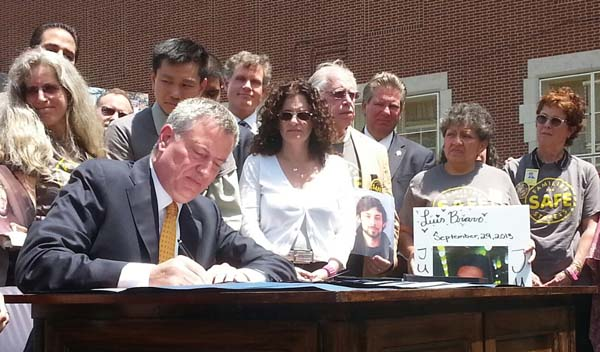 Mayor DeBlasio signing Vision Zero traffic bills.