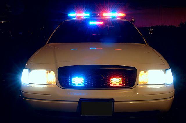Police Car with Emergency Lights On
