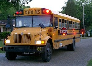 Economics may play a larger role in the sudden rise in illegal school bus passing. Photo courtesy Wikimedia Commons.
