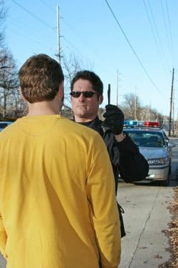man and cop sobriety test